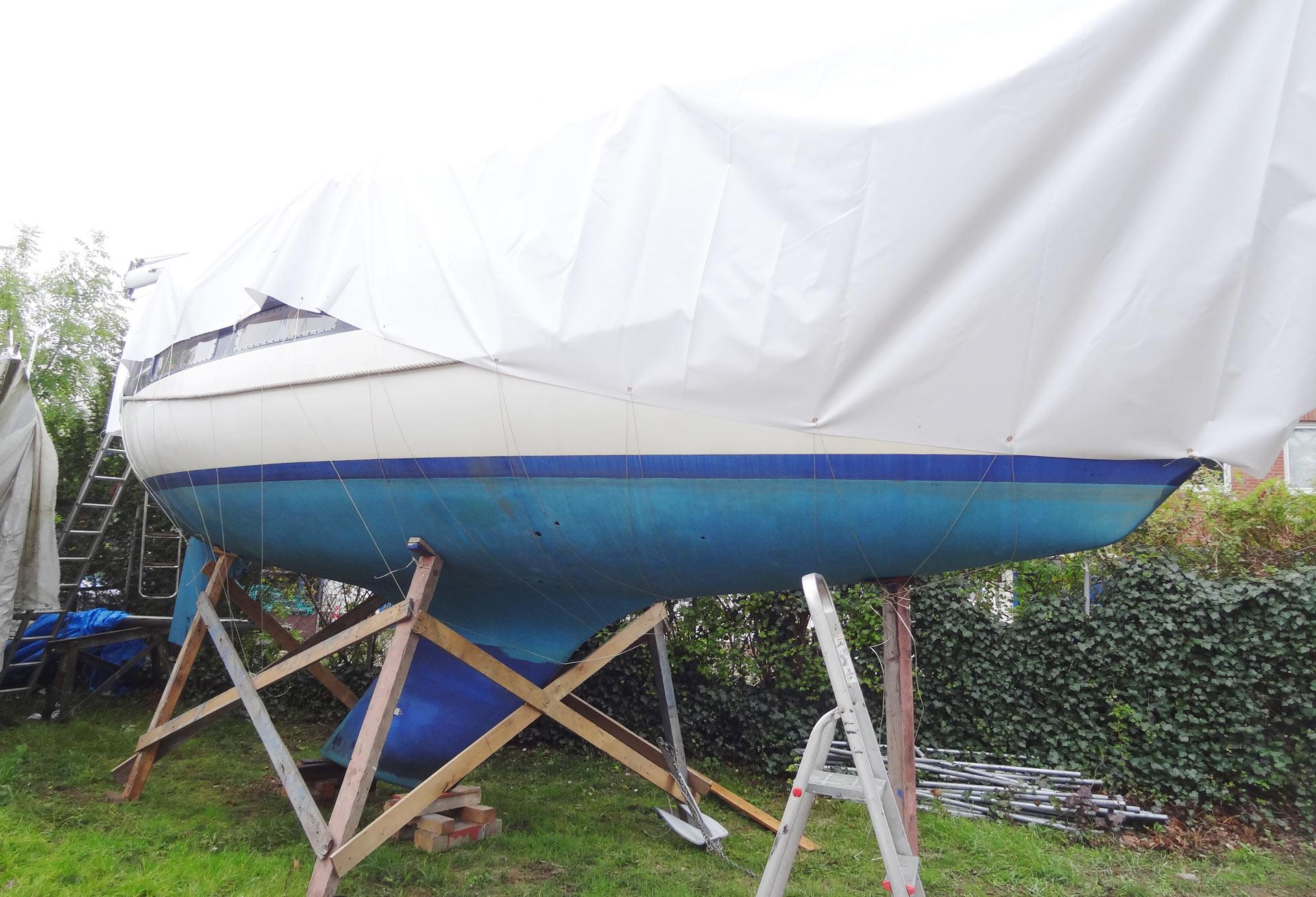 Finally: My yacht under her new tarp on land.