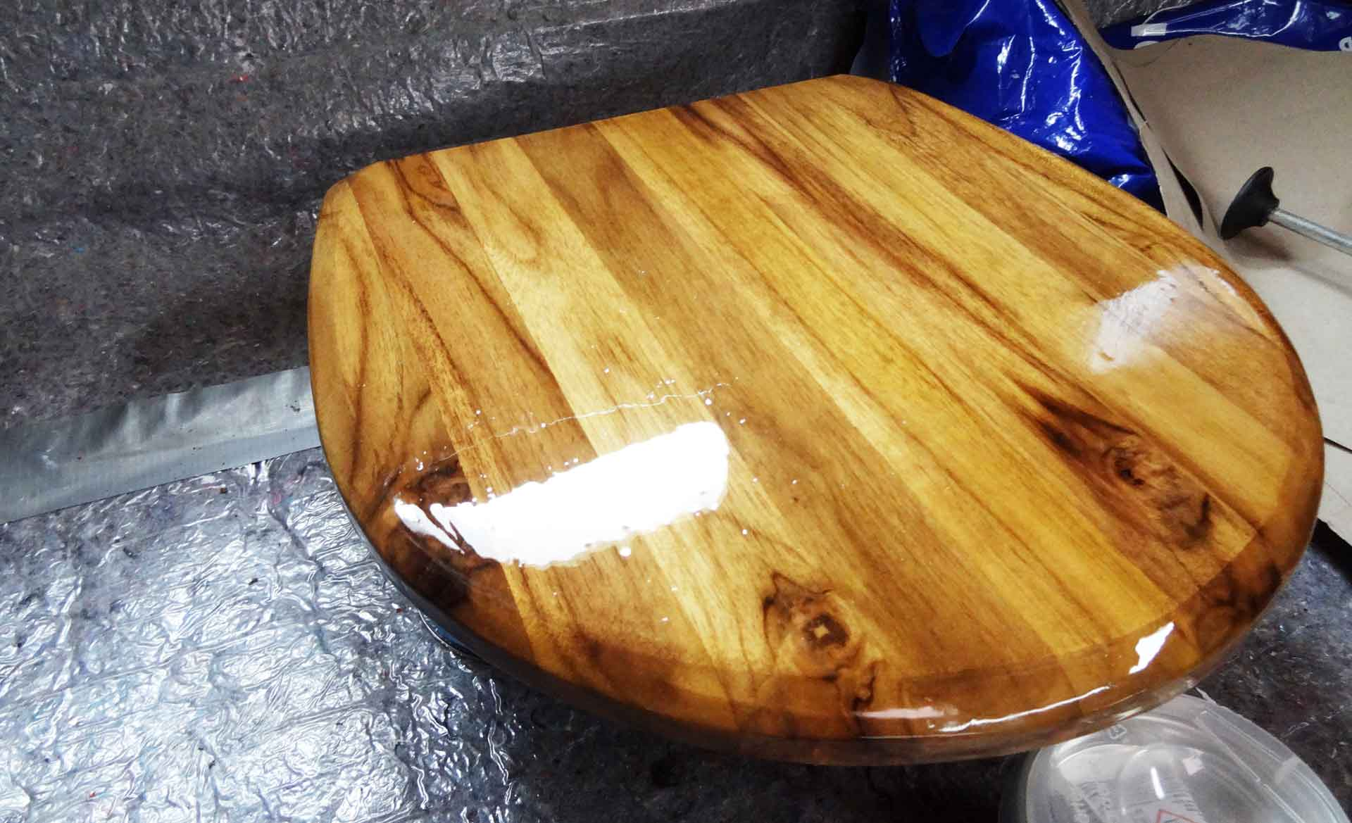 A perfect new Toilet Lid made of massive Teak